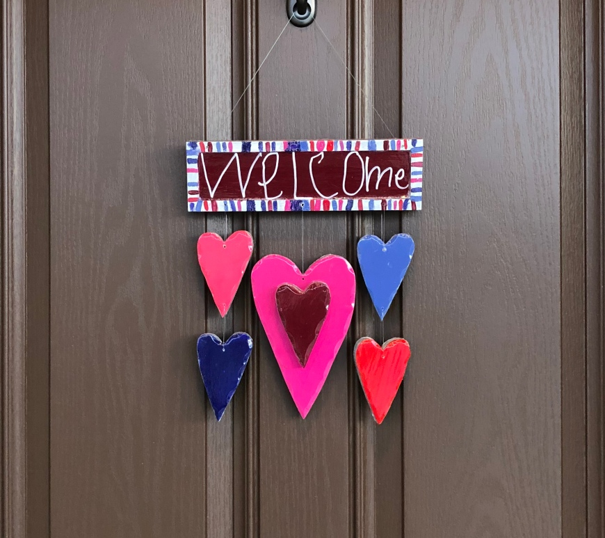 welcome sign with hearts