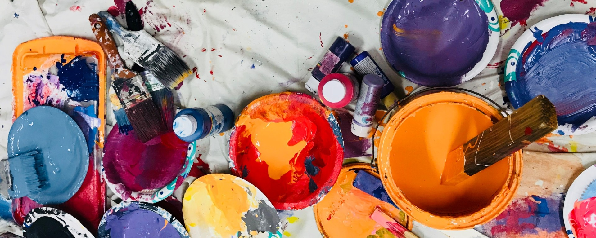 paint cans on paint cloth